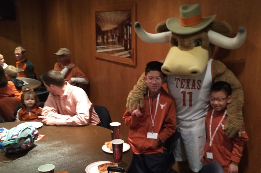 Kids take photos at a Longhorns Kids Club party - March 2015